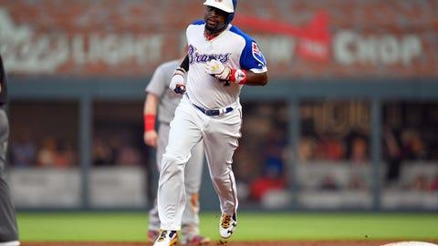 Aug 19, 2017; Atlanta, GA, USA; Atlanta Braves third baseman Brandon Phillips (4) runs the bases after hitting a home run against the Cincinnati Reds during the third inning at SunTrust Park. Mandatory Credit: Dale Zanine-USA TODAY Sports