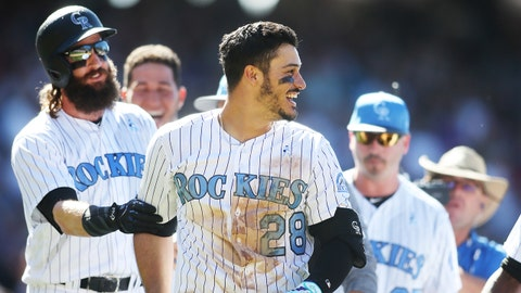 Jun 18, 2017; Denver, CO, USA; Colorado Rockies third baseman Nolan Arenado (28) celebrates with teammates after hitting a walk off three run home run to complete the cycle during the ninth inning against the San Francisco Giants at Coors Field. Mandatory Credit: Chris Humphreys-USA TODAY Sports