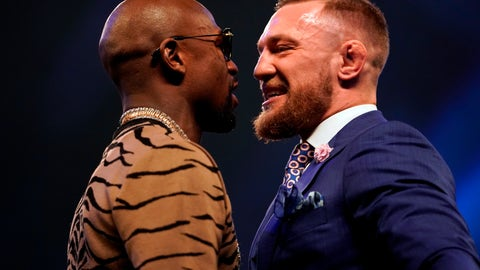 VIDEO: Conor McGregor and Floyd Mayweather stare down each other for the final time