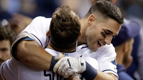 Tampa Bay Rays' Kevin Kiermaier, right, gets a hug from Steven Souza Jr. after Kiermaier hit a two-run home run off Toronto Blue Jays starting pitcher Marcus Stroman during the third inning of a baseball game Wednesday, Aug. 23, 2017, in St. Petersburg, Fla. (AP Photo/Chris O'Meara)
