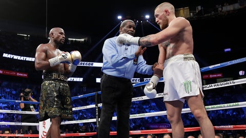 VIDEO: Conor McGregor thinks the ref stopped the fight too early, but Floyd Mayweather disagrees
