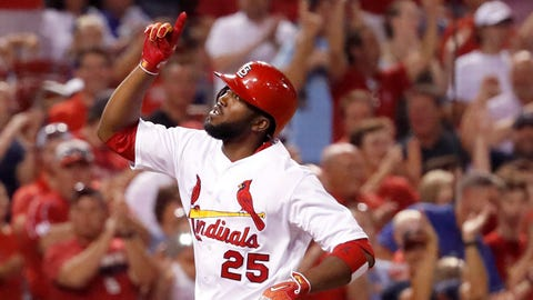 Cardinals survive Braves for 8th straight victory