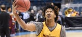 Gophers forward Curry out for season with knee injury