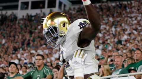 Notre Dame's Dexter Williams is lifted by Robert Hainsey as they celebrate Williams' receiving touchdown against Michigan State during the second quarter of an NCAA college football game, Saturday, Sept. 23, 2017, in East Lansing, Mich. (AP Photo/Al Goldis)