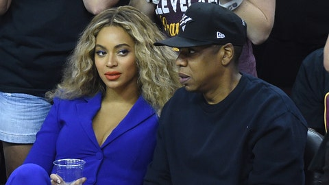 Jun 16, 2016; Cleveland, OH, USA; American rapper, entrepreneur and investor Jay Z (R) and American singer, songwriter, record producer and actress Beyonce (L) watch the first quarter of game six of the NBA Finals at Quicken Loans Arena. Mandatory Credit: Ken Blaze-USA TODAY Sports