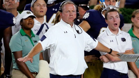 FILE - In this Saturday, Sept. 17, 2016 file photo, Notre Dame head coach Brian Kelly signals from the sideline during the first half of an NCAA college football game against Michigan State in South Bend, Ind. Brian Kelly kind of shrugged his shoulders and laughed when he was asked to list the most necessary areas of defensive improvement if this is to become a turnaround season for Notre Dame.(AP Photo/Charles Rex Arbogast, File)