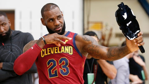 Cleveland Cavaliers' LeBron James (23) poses for the twitter mirror as Kendrick Perkins looks on during the NBA basketball team media day, Monday, Sept. 25, 2017, in Independence, Ohio. (AP Photo/Ron Schwane)