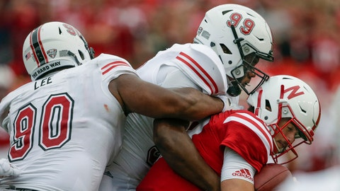 Northern Illinois defensive tackle Ben LeRoy (99) and defensive tackle William Lee (90) sack Nebraska quarterback Tanner Lee, right, during the first half of an NCAA college football game in Lincoln, Neb., Saturday, Sept. 16, 2017. (AP Photo/Nati Harnik)