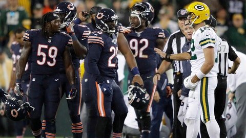 Sep 28, 2017; Green Bay, WI, USA; Green Bay Packers quarterback Aaron Rodgers (12) exchanges words with Chicago Bears inside linebacker Danny Trevathan (59) after Trevathan was called for a person foul after putting a hit on wide receiver Davante Adams (not pictured) at Lambeau Field.  Mandatory Credit: Dan Powers/Appleton Post-Crescent via USA TODAY Sports