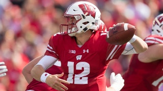 No.10 Wisconsin overcomes turnover problems to defeat Northwestern 33-24