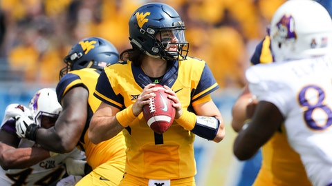 Sep 9, 2017; Morgantown, WV, USA; West Virginia Mountaineers quarterback Will Grier (7) drops back to pass during the second quarter against the East Carolina Pirates at Milan Puskar Stadium. Mandatory Credit: Ben Queen-USA TODAY Sports