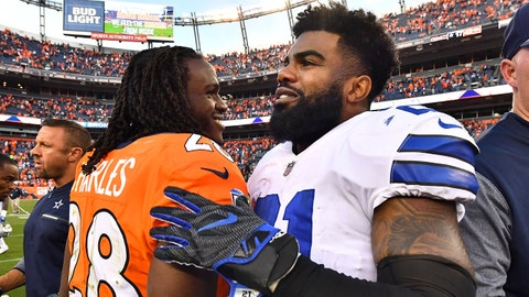 Sep 17, 2017; Denver, CO, USA; Denver Broncos running back Jamaal Charles (28) greets Dallas Cowboys running back Ezekiel Elliott (21) following the game in the second half at Sports Authority Field at Mile High. Mandatory Credit: Ron Chenoy-USA TODAY Sports