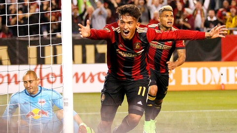 Atlanta United midfielder Yamil Asad (11) reacts after scoring a goal in the first half of an MLS soccer game against the New York Red Bulls, Sunday, March 5, 2017, in Atlanta. (AP Photo/Todd Kirkland)