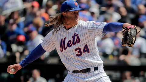 New York Mets pitcher Noah Syndergaard (34) delivers against the Atlanta Braves during the first inning of a baseball game, Monday, April 3, 2017, in New York. (AP Photo/Julie Jacobson)