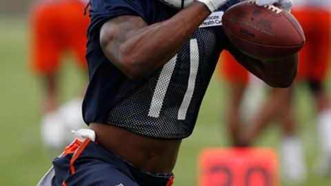 Chicago Bears wide receiver Kevin White misses a ball during NFL football training camp in Bourbonnais, Ill., Thursday, July 27, 2017. (AP Photo/Nam Y. Huh)