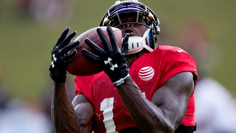 Atlanta Falcons wide receiver Julio Jones (11) makes a catch during the team's NFL training camp football practice Wednesday, Aug. 2, 2017, in Flowery Branch, Ga. (AP Photo/John Bazemore)