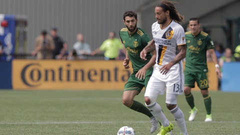 Los Angeles Galaxy's Jermaine Jones (13) holds the ball against the Portland Timbers during an MLS soccer match in Portland, Ore., Sunday, Aug. 6, 2017. (Sean Meagher/The Oregonian via AP)