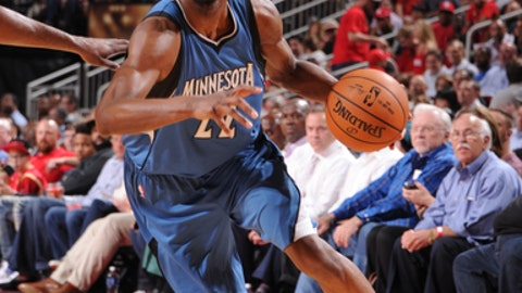 HOUSTON, TX - APRIL 12: Andrew Wiggins #22 of the Minnesota Timberwolves handles the ball against the Houston Rockets during the game on April 12, 2017 at the Toyota Center in Houston, Texas. NOTE TO USER: User expressly acknowledges and agrees that, by downloading and or using this photograph, User is consenting to the terms and conditions of the Getty Images License Agreement. Mandatory Copyright Notice: Copyright 2017 NBAE (Photo by Bill Baptist/NBAE via Getty Images)