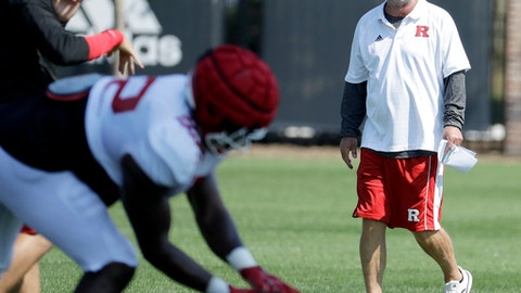 Rutgers offensive coordinator Jerry Kill watches his team work out during college football practice, Thursday, Aug. 10, 2017, in Piscataway, N.J.  Kill is back in football after taking time off to deal with epilepsy. (AP Photo/Julio Cortez)