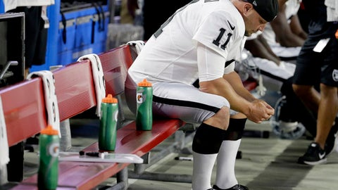 Oakland Raiders kicker Sebastian Janikowski sits on the bench after missing a field-goal attempt against the Arizona Cardinals during the first half of an NFL preseason football game, Saturday, Aug. 12, 2017, in Glendale, Ariz. (AP Photo/Rick Scuteri)