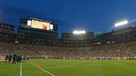 FILE - This is an Aug. 5, 2017, file photo showing the Green Bay Packers NFL football team practicing at Lambeau Field in Green Bay, Wisc. Notre Dame and Wisconsin will play at Lambeau Field in Green Bay, Wisconsin, in 2020 and Soldier Field in Chicago in 2021. The schools made a joint announcement on Monday, Aug. 14, 2017, in Chicago. The two-game series marks the first meeting between the Fighting Irish and Badgers since 1964. (AP Photo/Matt Ludtke, File)