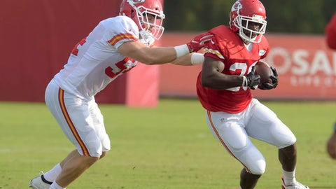Kansas City Chiefs linebacker Marcus Rush tries to stop running back C.J. Spiller during an NFL football practice Tuesday, Aug. 15, 2017, in St. Joseph, Mo. (Jessica A. Stewart/The St. Joseph News-Press via AP)