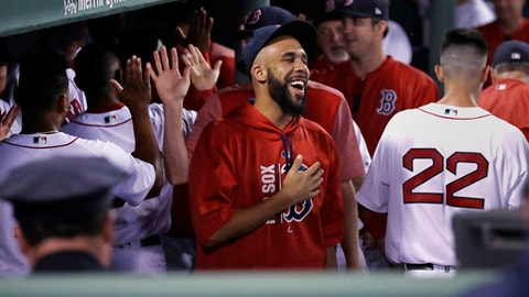 Boston Red Sox starting pitcher David Price, who is on the disabled list, laughs as he celebrates with teammates after the Red Sox infield turned a triple play during the fourth inning of a baseball game against the St. Louis Cardinals in Boston, Tuesday, Aug. 15, 2017. (AP Photo/Charles Krupa)
