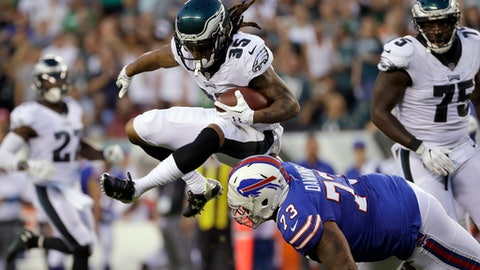 Philadelphia Eagles' Ronald Darby (35) returns an interception against Buffalo Bills' Dion Dawkins (73) during the first half of an NFL preseason football game, Thursday, Aug. 17, 2017, in Philadelphia. (AP Photo/Michael Perez)
