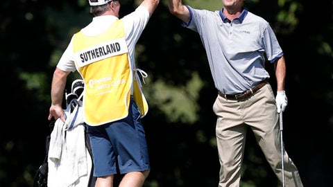 Kevin Sutherland, right, celebrates with his caddie after his eagle shot on the 18th hole during the final round of the PGA Tour Champions Principal Charity Classic golf tournament, Sunday, June 11, 2017, in Des Moines, Iowa. (AP Photo/Charlie Neibergall)