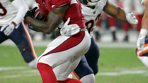 Arizona Cardinals running back Kerwynn Williams (33) is hit by Chicago Bears tight end MyCole Pruitt (83) during the first half of a preseason NFL football game, Saturday, Aug. 19, 2017, in Glendale, Ariz. (AP Photo/Ralph Freso)