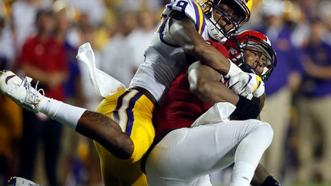 File-This Sept. 10, 2016, file photo shows Jacksonville State quarterback Eli Jenkins being sacked by LSU defensive end Arden Key (49) in the second half of an NCAA college football game in Baton Rouge, La. Key was named to the AP Preseason All-America Team on Tuesday, Aug. 22, 2017. (AP Photo/Gerald Herbert, File)