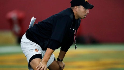 In this July 31, 2017, file photo, Iowa State coach Matt Campbell watches his team during an NCAA college football practice in Ames, Iowa. Iowa State's restructured defense will be considered a liability until it can prove otherwise. The Cyclones will look to counter a defense in flux with what could be one of the best offenses in school history. Iowa State (3-9 in 2016) opens its second season under coach Matt Campbell on Saturday against Northern Iowa. (AP Photo/Charlie Neibergall, file)