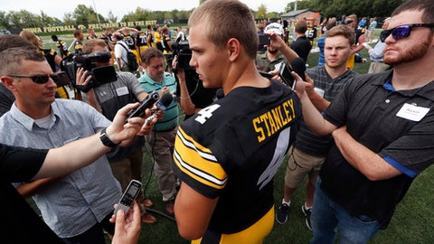 FILE - In this  Aug. 5, 2017, file photo,Iowa quarterback Nathan Stanley speaks to reporters during Iowa's NCAA college football media day, in Iowa City, Iowa. Iowa quarterback Nathan Stanley is such a mystery that few knew until Tuesday that he actually likes to be called Nate _ because when he hears Nathan, he assumes his mom is mad at him. Stanley, a 6-foot-5 sophomore, was officially named the Hawkeyes starter on Monday, Aug. 28, 2017 via a depth chart that listed him above Tyler Wiegers after a month-long competition between the two. (AP Photo/Charlie Neibergall, File)