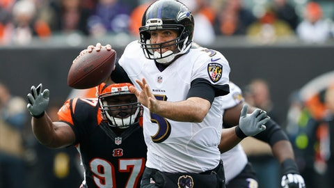 FILE - In this Sunday, Jan. 1, 2017 file photo, Baltimore Ravens quarterback Joe Flacco (5) looks to pass under pressure from Cincinnati Bengals defensive tackle Geno Atkins (97) in the first half of an NFL football game in Cincinnati. The AFC North revolves around QB longevity, except in Cleveland. No team in the division has been affected by injuries more than the Ravens, who are at it again. Flacco didn't play in the preseason because of a bad back the opener in Cincinnati will mark his debut. (AP Photo/Gary Landers, File)