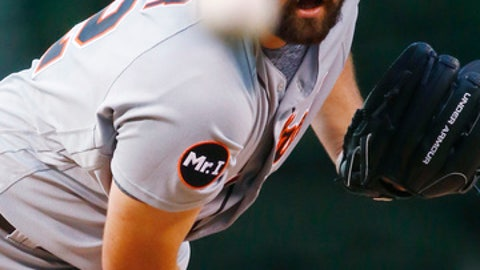 Detroit Tigers starting pitcher Michael Fulmer throws to a Colorado Rockies during the first inning of a baseball game Tuesday, Aug. 29, 2017, in Denver. (AP Photo/Jack Dempsey)