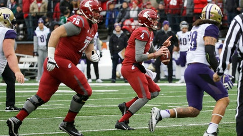 FILE - In this Nov. 25, 2016 file photo, Washington State offensive lineman Cody O'Connell (76) moves to provide protection for quarterback Luke Falk (4) during an NCAA college football game against Washington, in Pullman, Wash. When Cody O'Connell was a senior he was literally the biggest man on the campus of Wenatchee High School. At 6-foot-8 and more than 300 pounds at the time, few that could see eye-level with the massive O'Connell. Except this one kid. A sophomore named Trey Adams. Five years later, the former high school teammates are now two of the best offensive linemen in the country: Adams at No. 8 Washington and O'Connell at No. 24 Washington State. (AP Photo/Ted S. Warren, file)