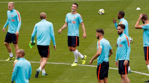Netherlands' players with Robin van Persie, center, attend a training session at the Stade de France stadium in Saint Denis, north of Paris, France, Wednesday, Aug. 30, 2017. France will play against Netherlands during their World Cup Group A qualifying soccer match on Thursday, Aug.31. (AP Photo/Christophe Ena)