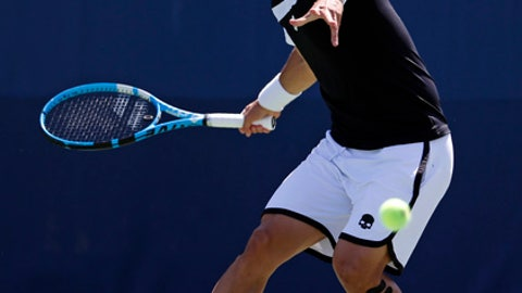 Fabio Fognini, of Italy, returns a shot from Stefano Travaglia, of Italy, during the first round of the U.S. Open tennis tournament, Wednesday, Aug. 30, 2017, in New York. (AP Photo/Michael Noble)