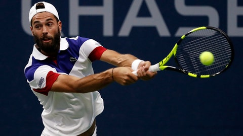 Benoit Paire, of France, returns a shot from Mischa Zverev, of Germany, during the second round of the U.S. Open tennis tournament, Wednesday, Aug. 30, 2017, in New York. (AP Photo/Andres Kudacki)