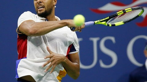 Jo-Wilfried Tsonga, of France, returns to Denis Shapovalov, of Canada, at the U.S. Open tennis tournament in New York, Wednesday, Aug. 30, 2017. (AP Photo/Kathy Willens)