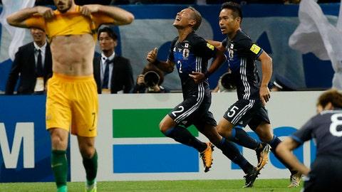 Japan's Yosuke Ideguchi (2) celebrates after scoring a goal against Australia during their World Cup Group B qualifying soccer match in Saitama, Japan, Thursday, Aug. 31, 2017. (AP Photo/Shuji Kajiayma)