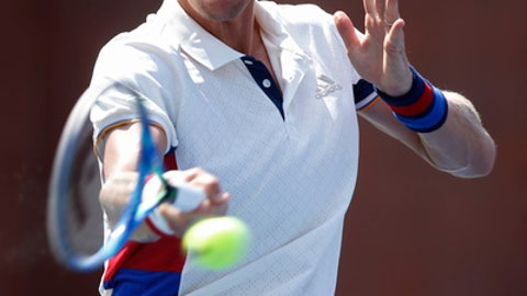 Tomas Berdych, of the Czech Republic, returns a shot from Alexandr Dolgopolov, of Ukraine, during the second round of the U.S. Open tennis tournament, Thursday, Aug. 31, 2017, in New York. (AP Photo/Jason Decrow)