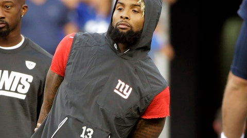 New York Giants wide receiver Odell Beckham watches his teammates warm up before an NFL preseason football game against the New England Patriots, Thursday, Aug. 31, 2017, in Foxborough, Mass. (AP Photo/Steven Senne)