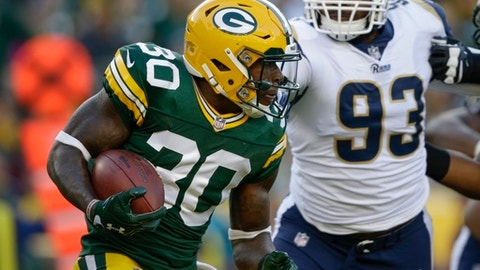 Green Bay Packers' Jamaal Williams runs past Los Angeles Rams' Ethan Westbrooks (93) during the first half of a preseason NFL football game Thursday, Aug. 31, 2017, in Green Bay, Wis. (AP Photo/Jeffrey Phelps)