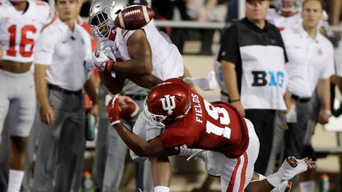 Ohio State's J.K. Dobbins, left, cannot catch a pass as Indiana's Tony Fields defends during the first half of an NCAA college football game, Thursday, Aug. 31, 2017, in Bloomington, Ind. (AP Photo/Darron Cummings)