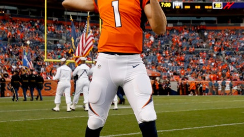 Denver Broncos quarterback Kyle Sloter (1) warms up prior to an NFL preseason football game against the Arizona Cardinals, Thursday, Aug. 31, 2017, in Denver. (AP Photo/Jack Dempsey)