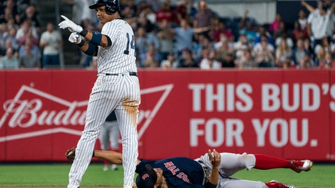 New York Yankees' Starlin Castro is safe at second base as Boston Red Sox's Xander Bogaerts holds the tag during the fourth inning of a baseball game Thursday, Aug. 31, 2017, in New York. (AP Photo/Craig Ruttle)