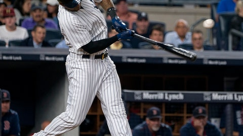 New York Yankees' Aaron Hicks hits a single against the Boston Red Sox during the fifth inning of a baseball game Thursday, Aug. 31, 2017, in New York. (AP Photo/Craig Ruttle)