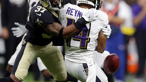 Baltimore Ravens wide receiver Keenan Reynolds (14) fumbles the ball as New Orleans Saints cornerback Arthur Maulet (37) attempts to recover, during the second half of an NFL preseason football game, Thursday, Aug. 31, 2017, in New Orleans. (AP Photo/Rusty Constanza)