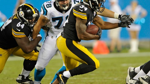 Pittsburgh Steelers' Knile Davis (34) runs past Carolina Panthers' Connor Wujciak (78) in the second half of an NFL preseason football game in Charlotte, N.C., Thursday, Aug. 31, 2017. (AP Photo/Mike McCarn)